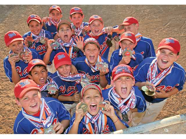 The William S. Hart PONY League Mustang All-Stars show the medals they have been awarded over the course of the season. They won the Mustang World Series on Aug. 7 and will next play in the 2010 National Youth Baseball Championships.