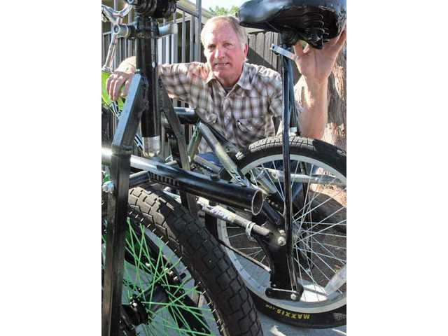Local inventor Doug Fraser stands behind one of his bicycles, which he received a patent for July 27.