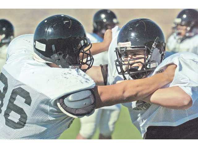 Golden Valley linemen Jonathan Carrillo, left, and Luis Sanchez, right, go head-to-head during practice on Monday at Golden Valley High School.