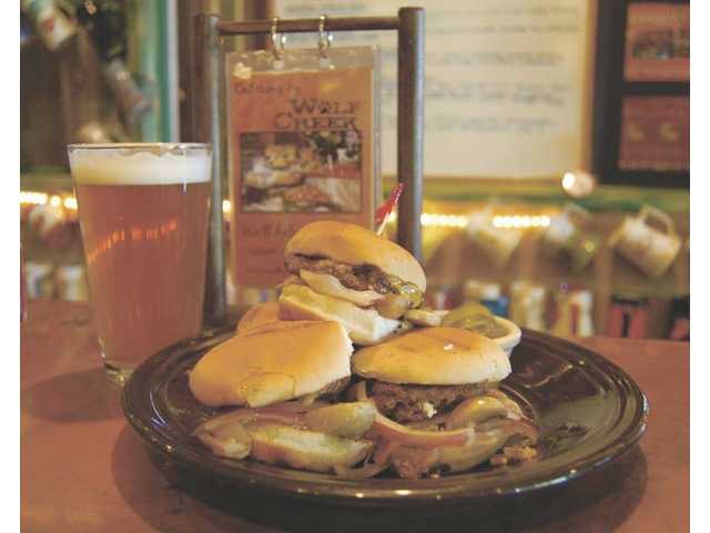 A plate of Wolf Creek Restaurant & Brewing Company's Road House Sliders ($7.95).