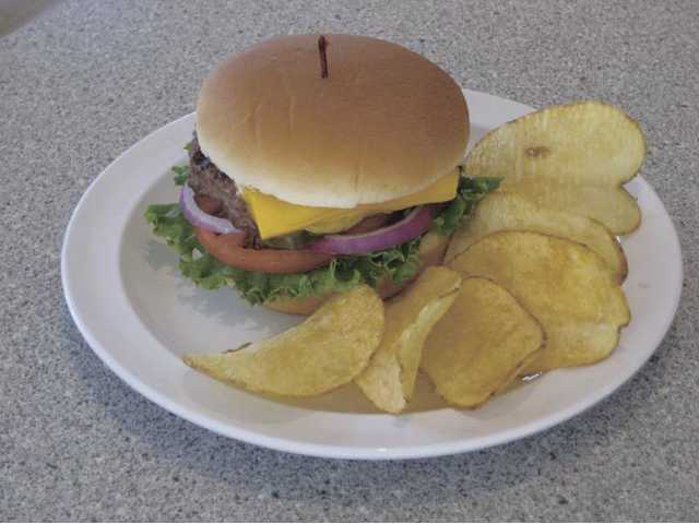 The enticing cheeseburger and chips from FreshWorks California Grill. You can see the freshness.