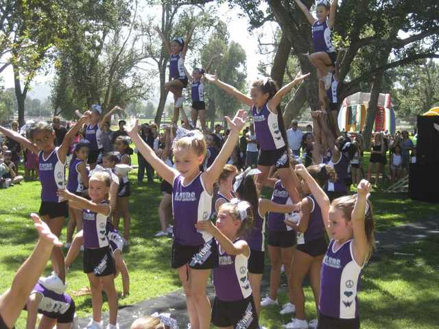 Young girls from Gym Cheer were one of many groups offering free entertainment at the fourth annual Day for Kids in 2009, which was attended by 5,000 people.