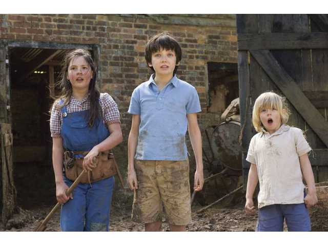 "From left, Lil Woods, Asa Butterfield and Oscar Steer are shown in a scene from  ""Nanny McPhee Returns."""