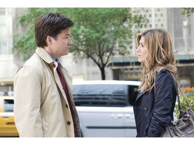"Jason Bateman, left, and Jennifer Aniston are shown in a scene from ""The Switch,"" which opens this week."