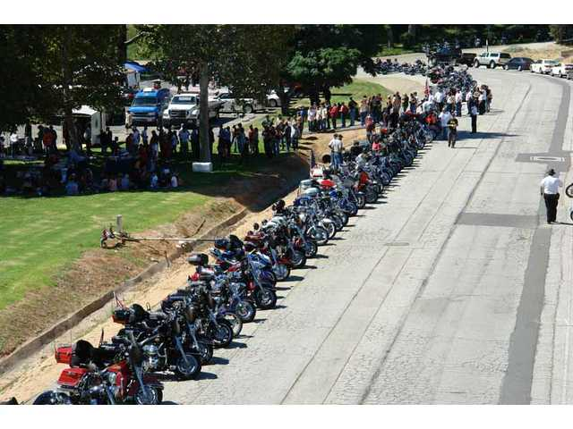 Dozens of motorcyclists participated in the Downed Officer's Support Ride at Mann Biomedical Park Sunday.