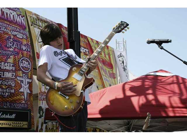 The Feaver's Braeden Lemasters rips a solo on his Les Paul at the 2010 Summer Meltdown concert in May.