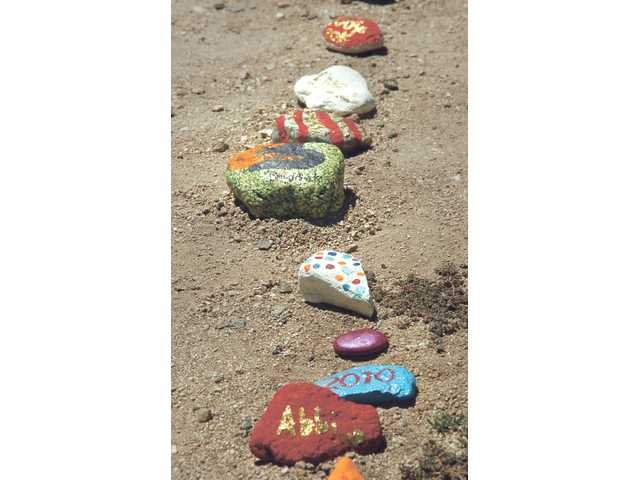 Each camper paints a personalized spirit stone that lines the walkways at The Painted Turtle Camp, which offers children with chronic and life-threatening disabilities a chance to get away from their daily troubles and enjoy outdoor experiences with a staff and other campers that understand their difficulties.