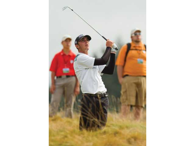 Valencia graduate Max Homa watches his tee shot on the 15th hole during the quarterfinals of match play at the 2010 U.S. Amateur Championship at Chambers Bay Golf Course in University Place, Wash. on Friday. Homa was defeated 1 up by Ben An.