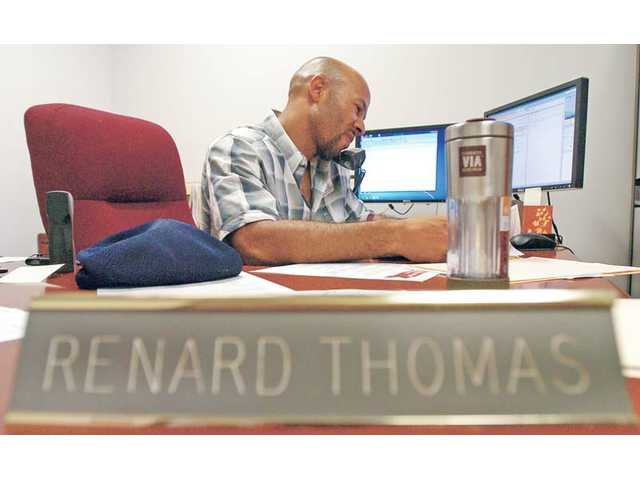 In this recent photo, Veteran Affairs Program Manager Renard Thomas works at his desk at the Adult Veterans Re-entry Center at College of The Canyons.