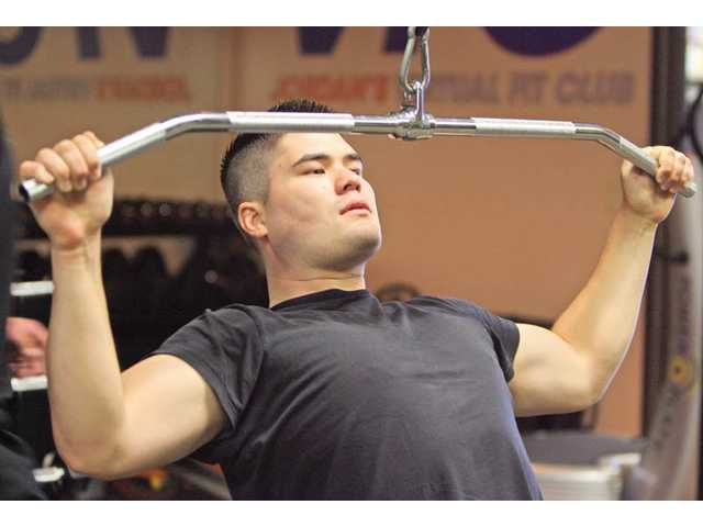 Iraq veteran Steven Watanabe, 24, works out at Jordan's Virtual Fit Club in Valencia on Aug. 11. Watanabe is learning to adjust to civilian life after serving overseas, and the Saugus resident is working to become a personal trainer.