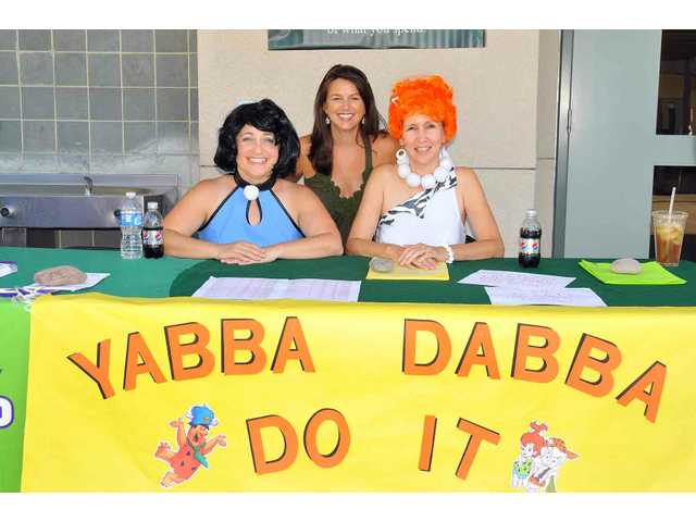 Yabba-dabba-doing it on back-to-school night at North Park Elementary School are (from left): Wendy Powell, preschool teacher; Joy Goff, PTA membership chair; and DeAnna Waters, PTA parent volunteer.