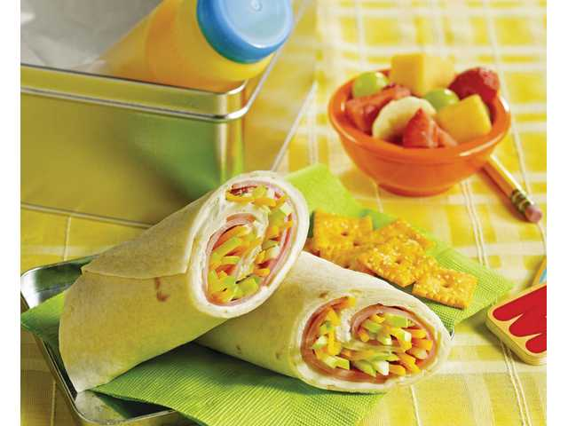 Sweet ham roll-ups are an innovative sandwich idea to jazz up any child's lunchbox.