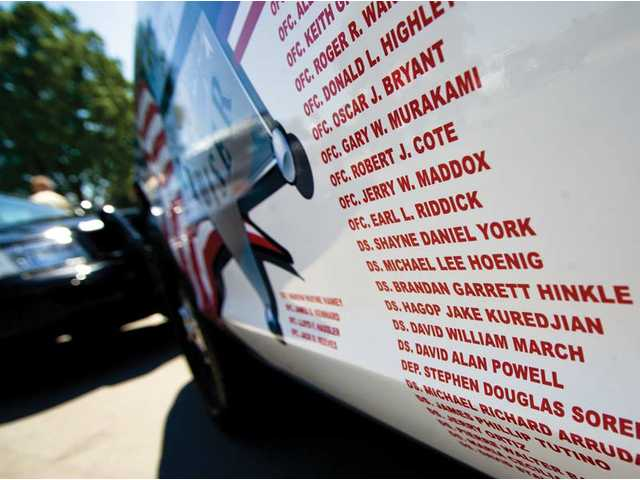 A sheriff's cruiser (above right) detailed with the names of 477 Sheriff's Department personnel killed in the line of duty in California since 1850.