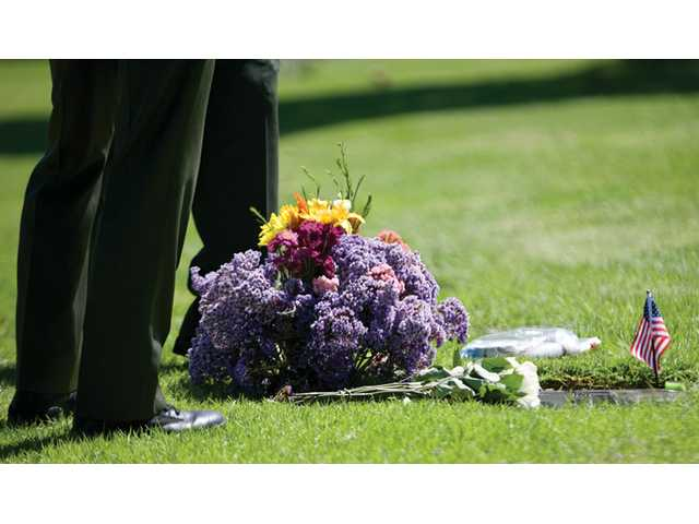 """Sheriff's deputies stand over the grave of Deputy Hagop """"Jake"""" Kuredjian, who was killed during an Aug. 31, 2001, Stevenson Ranch shootout, Tuesday at Forest Lawn Memorial Park in Hollywood Hills."""