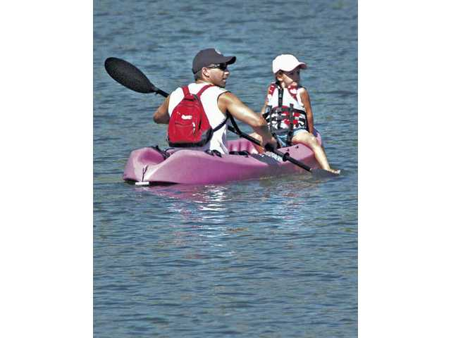 Eric Coffey, of Castaic, takes his daughter Payton, 4, for her first kayak ride on the lower Castaic Lake on Wednesday.