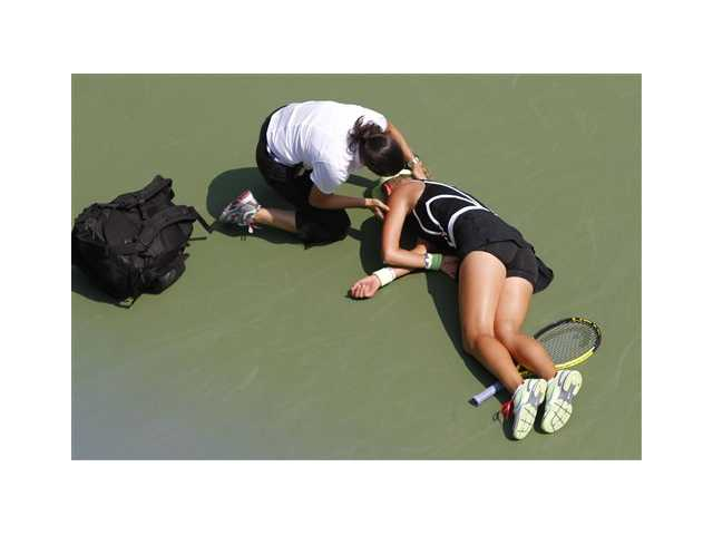 Azarenka collapses, wheeled off court at U.S. Open