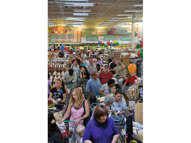 Shoppers amass at the Sprouts Farmers Market grand opening Wednesday. The Valencia market opened in the old Mervyn's building and is open 7 a.m. to 10 p.m. daily.