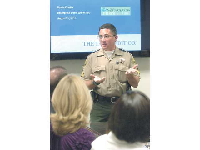 Ron Shaffer of the Santa Clarita Valley Sheriff's Station addresses a group of business professionals at a city of Santa Clarita enterprise-zone workshop held at City Hall on Wednesday.