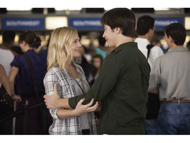 "Drew Barrymore, left, and Justin Long are shown in a scene from Warner Bros.' ""Going the Distance."""