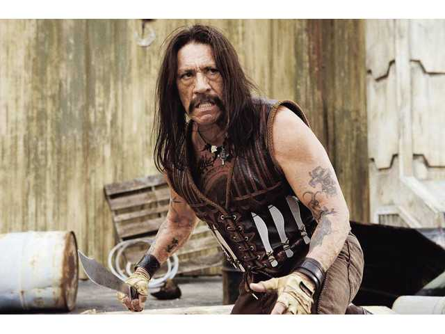 "Danny Trejo plays a legendary ex-Federale in a scene from 20th Century Fox's ""Machete."""