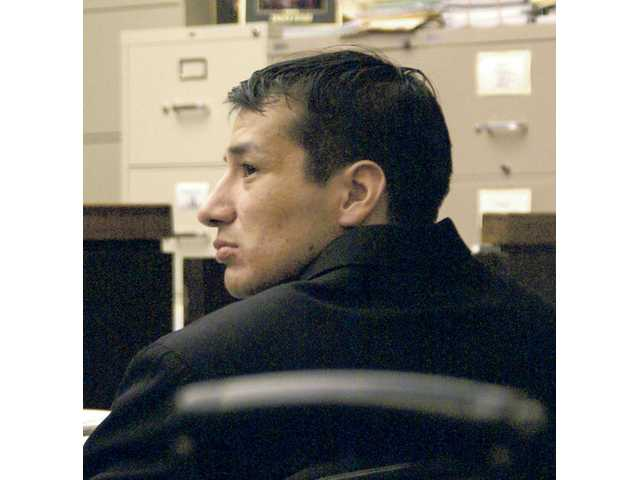 Antonio Rodriguez sits in a San Fernando court room listening to testimony during his trial for the murder of Desarie Saravia. He was sentenced to death Thursday by Judge Ronald S. Coen.