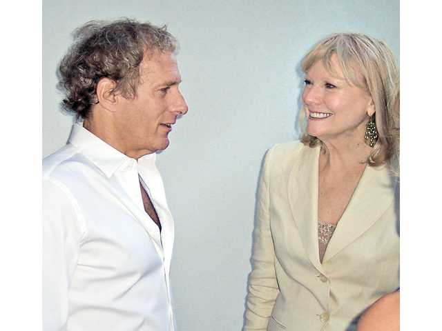 Michael Bolton speaks with Erica Betz at the fundraising event.