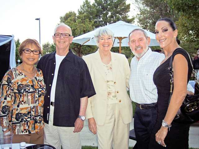"Ami and Remo Belli, Rita and Lou Garasi and Shelley Hann enjoy the warm summer evening at the Michael Bolton VIP ""meet and greet"" fundraiser to benefit the PAC K-12 Arts Education Outreach Program at College of the Canyons."