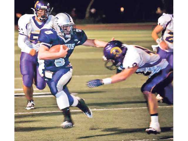 Former Saugus running back Ryan Zirbel (5) rushes against Santa Maria in 2008. Zirbel is hoping a big season with College of the Canyons will attract NCAA Division I schools.