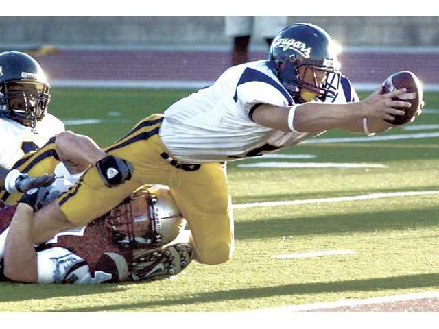 College of the Canyons running back Ryan Zirbel, a Saugus High graduate, dives over the goal line for a touchdown on Saturday at Antelope Valley College.