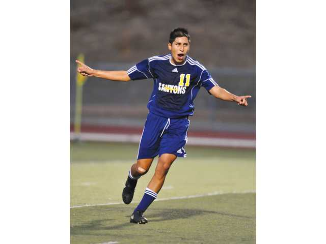 College of the Canyons' Andres Bueno celebrates his goal in the 19th minute against Taft College on Tuesday at COC.