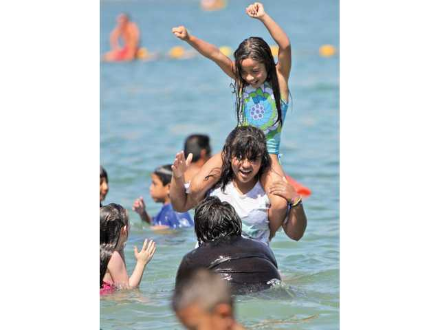 Children cool off in the lower part of Castaic Lake as part of the thousands who celebrated Labor Day at the lake on Monday.