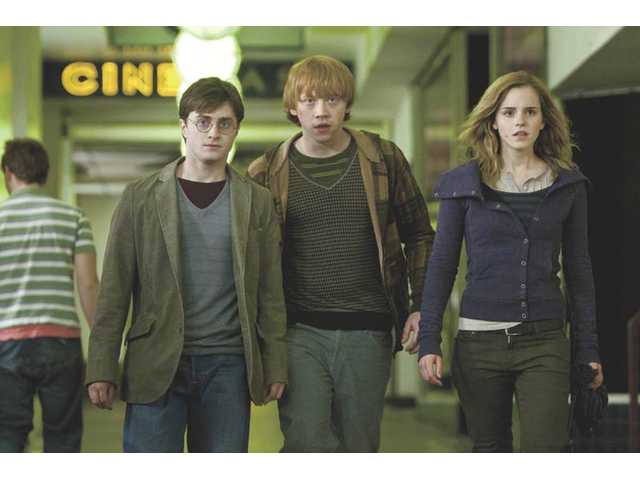 "From left, Daniel Radcliffe, Rupert Grint and Emma Watson in ""Harry Potter and the Deathly Hallows - Part 1."""