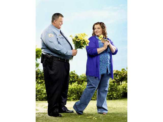 "Billy Gardell stars as Officer Mike Biggs, and Melissa McCarthy stars as Molly Flynn, in the new CBS comedy ""Mike & Molly,"" which premieres Monday, Sept. 20 at 9:30 p.m."