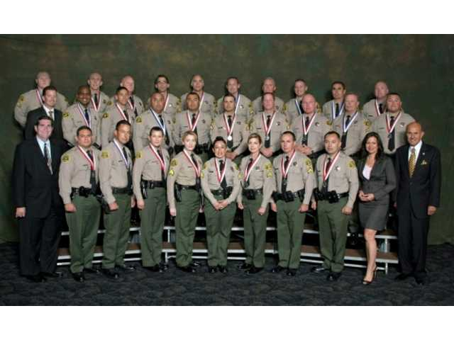Sheriff Lee Baca presented 29 members of the Los Angeles County Sheriff's Department with the department's highest honors during the Medal of Valor and Meritorious Conduct Awards Ceremony on Sept. 8 in Montebello.
