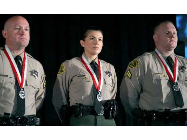 Sheriff Lee Baca honors local deputy with award