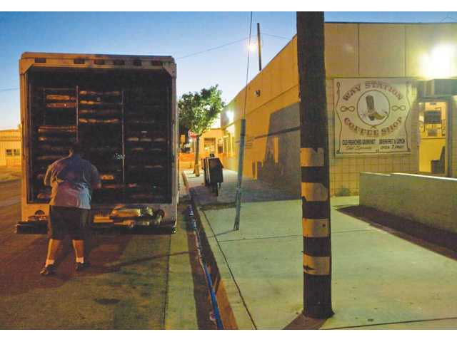 Manny Arreguin with Puritan Bakery unloads a fresh bread delivery for the Way Station.