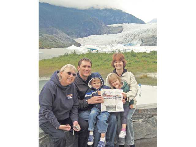 The Hoffman family — from left, Margie, Brian, Zachary Julina and Jaci — sit in front of the Mendenhall Glacier in Juneau, Alaska, on Aug. 25 as part of a weeklong cruise with Princess Cruises.