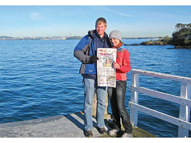 Nadine Zuckerman and her boyfriend, Andy Olson, hold up a newspaper on Motutapu Island near the city of Auckland, New Zealand on July 14. The Maori people had occupied the island more than 100 years ago before a volcanic eruption destroyed their settlements.
