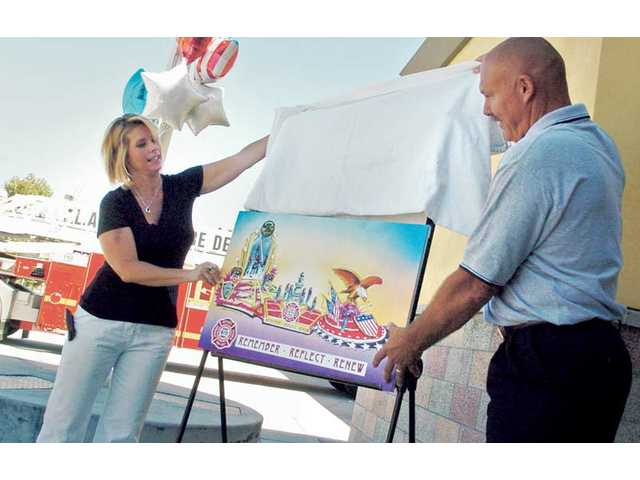 "Merrie Thomsen, left, and her husband, Jerry, of the L.A. County Firemen's Benefit and Welfare Association, unveil a rendering of its Rose Parade entry ""Remember, Reflect, Renew"" in Valencia on Friday. The SCV Newhall Optimist Club has a free parade ticket for each donation of at least $100 to the association. For more information, call (661) 252-7313."