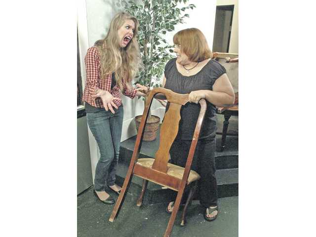 Nikki Santino, left, is an irate customer as Denise Koek tries to sell her furniture. Santino is part of The Horse and Saddle Jubilation Good Times Improv Brigade, and Koek is one of the Improv Festival workshop instructors.