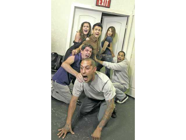 From front, Steven Huerta, Kevin Darga, Joaquin Garay, III, Katie Meyer, Shelley Pack and J.R. Cruz, right, improvise a scene about heading for the exits in a fire. These artists make up The Gardeners improv group, which will be performing at the Improv Festival.