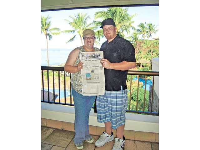 Elizabeth and David Mills took The Signal on their honeymoon in Maui, Hawaii.