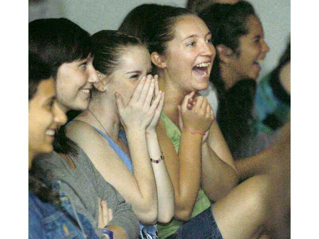 "Ashley Veurink, center left, and Chelsea Cox laugh as they watch the ""We Got Scissors"" improv show on Thursday night."