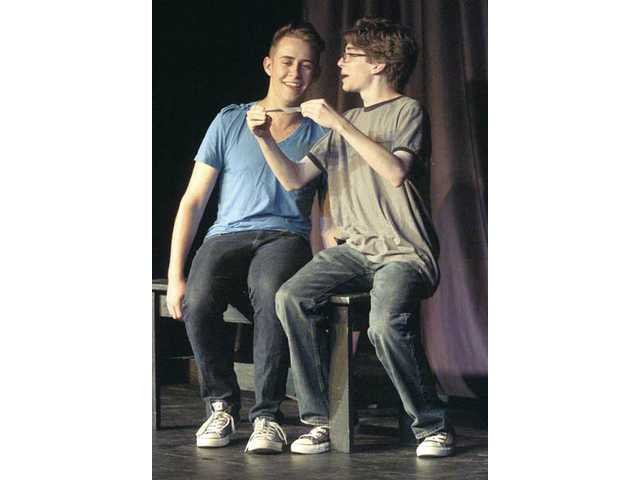 "Saugus High School students Jacob Thomson, left, and Josh Clark read a suggestion for a new line to be added to a scene as they improvise in a game called pocket lines at the ""We Got Scissors"" improv show."