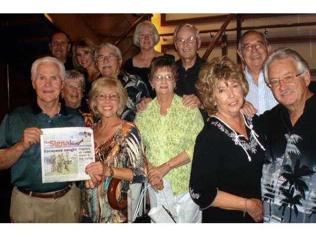 To celebrate Jim and Linda Smith's (left, with The Signal) 45th wedding anniversary, a group of friends went on a cruise to the Mexican Riviera. Also pictured are Rick and Gail Herrington, Hal and Ann Malm, Dean and Jean Waugh, Lee and Gloria Martinez, Pat Herrera and Michael Waldo.