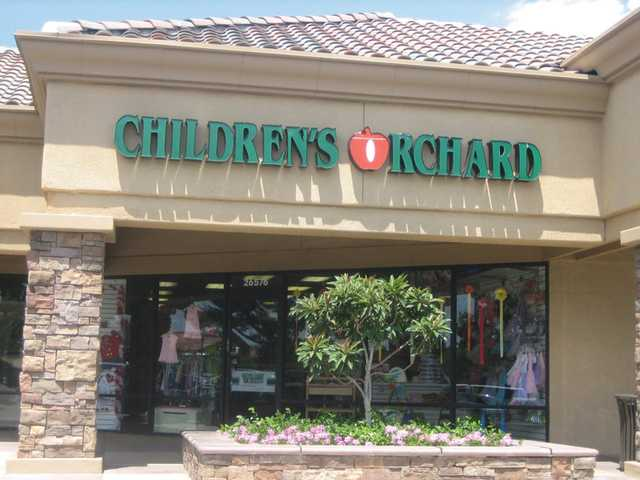 Jobless with a second set of twins on the way, Janelle Costello opened Children's Orchard in the Bouquet Canyon shopping center. The store sells upscale and high-end brand clothing for children ranging in size from newborn to 14 for a fraction of the retail price.