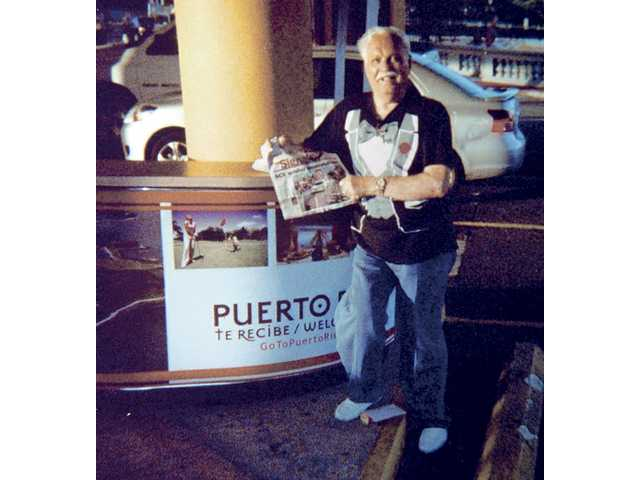 Nat Aboulafia holds a copy of The Signal during a recent cruise in Puerto Rico.