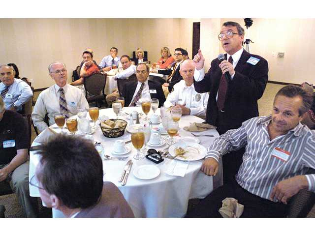 Nick Brestoff asks a question to the Editorial Board at the Valley Industrial Association luncheon in Valencia on Tuesday.