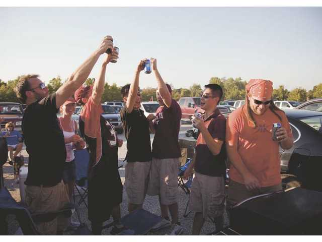 Virginia Tech fans in Maryland tailgate-party hearty in the parking lot.