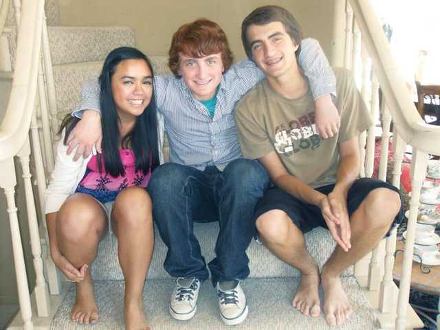 Brothers Robin Levy, right, 15, and Jacob Levy, 13, middle, have a loving relationship with adopted sister, Moriah Levy, 13. Moriah said she wants other adopted youth to know that they're not any different than kids that aren't adopted.